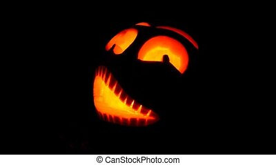 Halloween pumpkin - Shining scary halloween pumpkin face at...