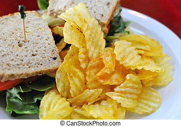 Fast food set meal of potato chips and sandwiches Suitable...