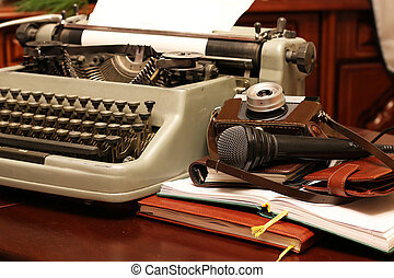 typewriter and camera retro - Instruments employee news...