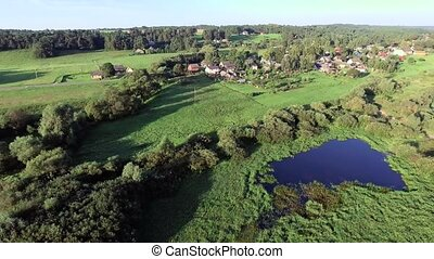 aerial landcape of river in green meadows - aerial view of...