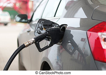 fill up with petrol - gun filling unit on the fuel tank...