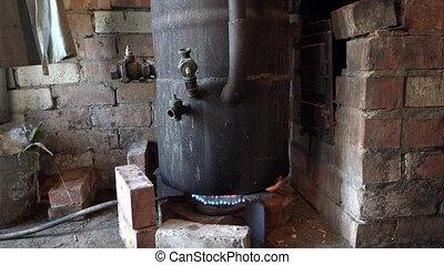 old black vat boil on the fire in rural kitchen. 4K