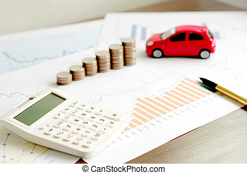 With Car Model And Stack Of Coins On Desk