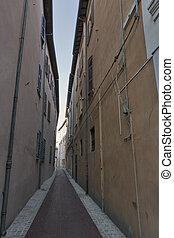 Old narrow street in Rimini, Italy.