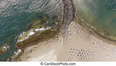 Overhead view of beach and rocks