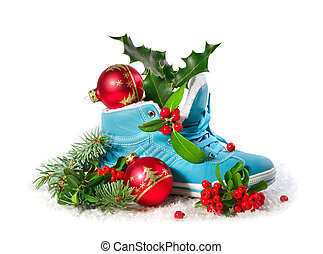 Blue shoe with Christmas decorations isolated on white...