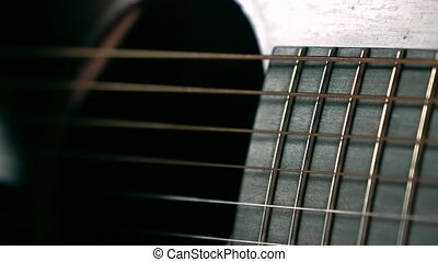 Guitarist hand and strings. Music performance. Slow motion...