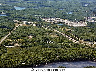 Parry Sound outskirts, aerial - aerial view of a shopping...