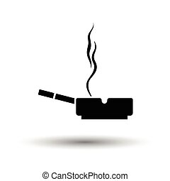 Cigarette in an ashtray icon. White background with shadow...
