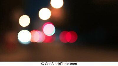 Bokeh shot of moving blurred lights in night city. Vintage...