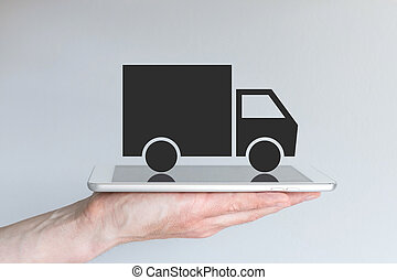Digital transportation / logistics with truck icon on tablet