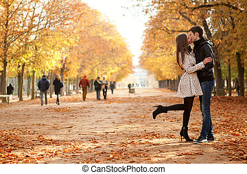 Young beautiful couple in the Luxembourg garden at fall....