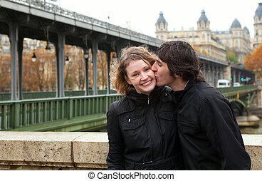 Dating couple in Paris at rainy weather