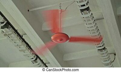 Orange ceiling fan in a loft style oldschool room in action