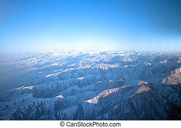 Flight over Pamir and Tien Shan 1. Air travel. Visible deep...