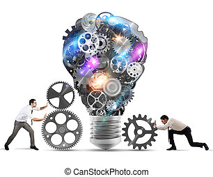 Teamwork powering an idea - Business team push gears towards...