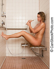 Beautiful naked blond young woman takes shower - Gorgeous...