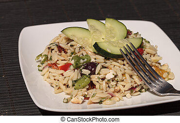 Greek orzo salad with cucumbers, sundried tomatoes, olives,...