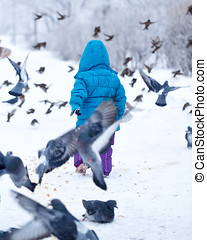 Cute little girl and pigeons - Cute little girl on a walk in...