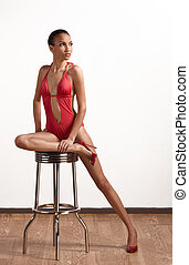 Creole ethnic woman in red one piece swimsuit - Young...