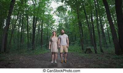 Girl standing in the woods with her boyfriend - Girl with...