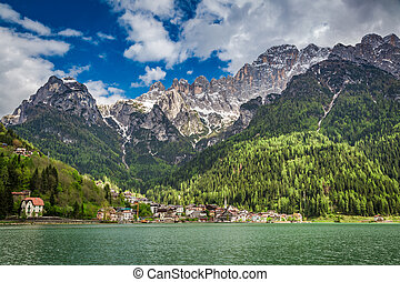 Breathtaking view of small town by the lake in Dolomites
