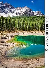 Beautiful view to mountain Carezza lake in Dolomites, Italy