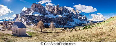 Panorama of small church at Passo Gardena, Dolomites, Italy