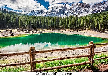 Breathtaking view to mountain Carezza lake in spring, Alps,...