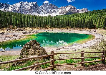 Sunny day in mountain Carezza lake in Dolomites, Italy