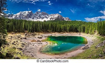 Sunny day in mountain Carezza lake in spring, Alps, Italy