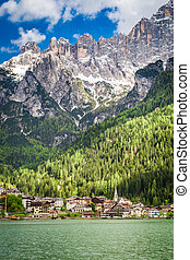 Wonderful view of small town by the lake in Dolomites