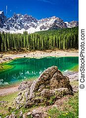 Stunning view to mountain Carezza lake in Dolomites, Italy