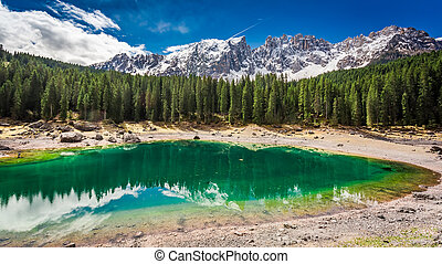 Stunning view to mountain Carezza lake in spring, Alps,...