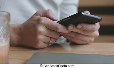 Woman using smart phone - Cropped close up female hands...