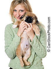 Young woman with a pekinese