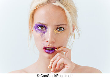 Beauty portrait of young female with creative makeup