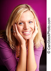 Atractive blonde woman in violet sweater.
