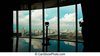 The observation deck on a skyscraper with people in Saigon....