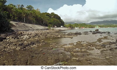 Dirty coast on the road. Philippines. - Dirty coast on the...