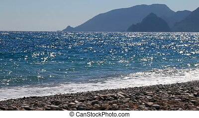 Background of waves of the sea on the beautiful pebble...