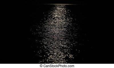a lunar path is in a nightly sea