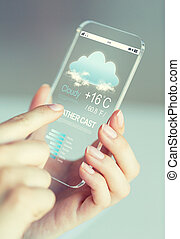 close up of hands with weather cast on smartphone -...