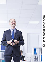 Smiled man in suit in bright office - Shot of smilled man in...