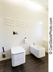 Bathroom with tooilet and urinal - Tiled bathroom interior...