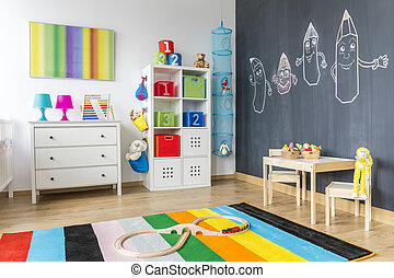 Child room with colorful rug - View of child room with...