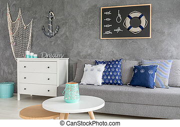 Stylish grey living room with nautical decorations and...