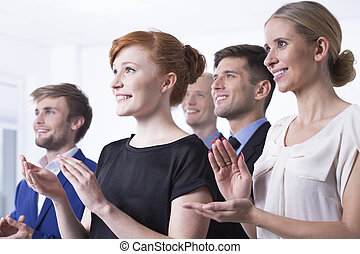 Office employees clapping their hands - Office employees...