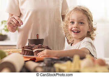 Child willing to eat muffin - Happy and smiling child...