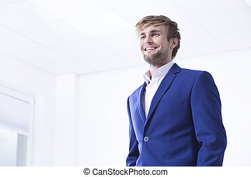 Handsome man in office interior - Elegant and handsome young...